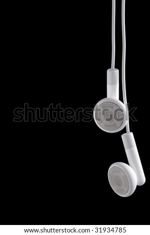 Modern portable audio ear phones, isolated on a black background. - stock photo