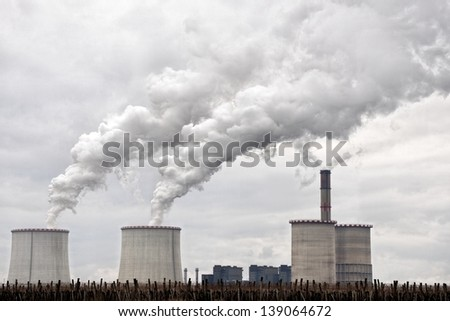 Modern power plant exhausting large amount of vapor outdoors - stock photo
