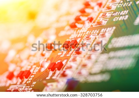 Modern printed circuit board with light effects. Closeup with extremely shallow DOF. - stock photo