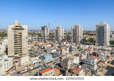 Modern private houses and modern residential buildings in new neighborhood of Kiryat Gat - city in southern district of Israel. - stock photo