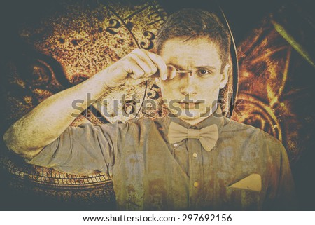Modern prophet holds key to his eye, as a symbol of prophecies of future. The prophecy of future events Oracle with time retro background. Young serious man in shirt and bow tie holds door locker.