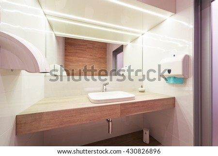 Modern public empty restroom with washstand mirror. Woman Public Bathroom Mirror Stock Images  Royalty Free Images