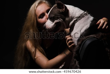 modern punk fashion, portrait of a beautiful model posing with American staff terrier