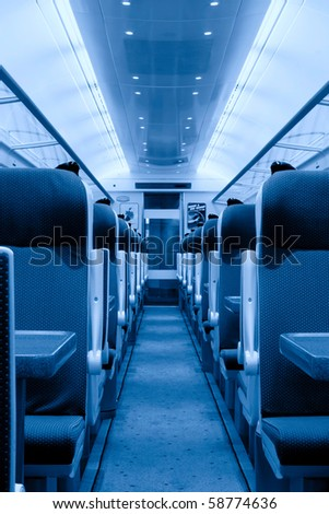 modern railway coach interior illuminated and  row of seats, monochromatic