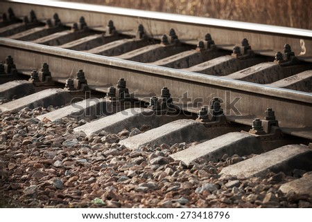Modern railway details, close-up photo with selective focus and shallow DOF - stock photo