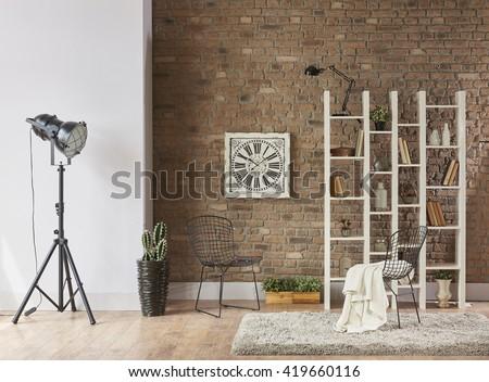 modern reading corner behind natural brick wall living room interior - stock photo