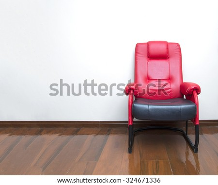 Modern red and black leather armchair sofa on wood floor interior, room - stock photo