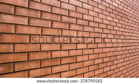 Modern red brick wall surface in perspective as background image