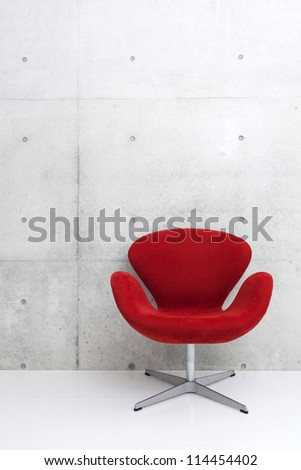 modern red chair and concrete wall