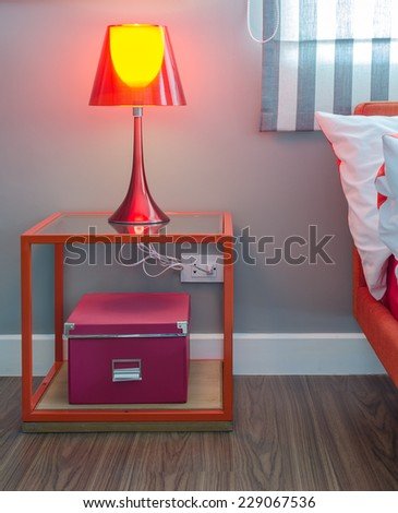 modern red lamp on red table at home - stock photo