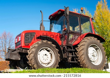 Modern red tractor outdoors