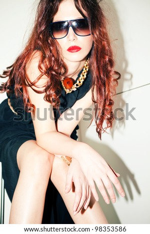 modern redhead young woman portrait with sunglasses, indoor shot - stock photo