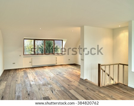 Modern renovated interior with wooden floor - stock photo