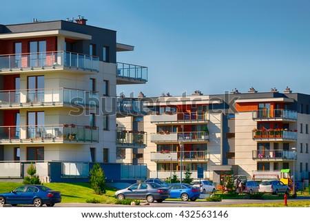 Modern residental buildings of brick and glass on urban street. - stock photo