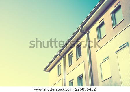 Modern Residential Apartment Block in Urban Area with a retro vintage instagram filter effect - stock photo