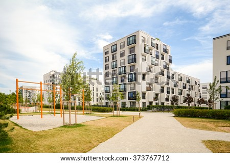 Modern residential buildings with outdoor facilities and children's playground, Facade of new apartment house - stock photo