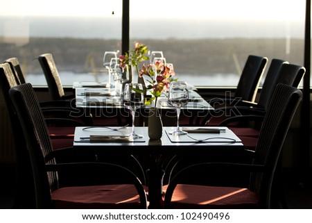 Modern restaurant interior with scenic seaside view - stock photo