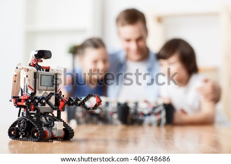 Modern robot standing on the table  - stock photo