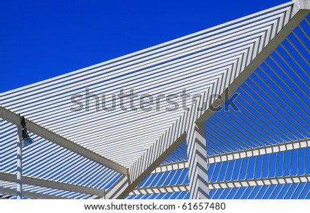 modern roof architecture with white steel and blue sky in the background