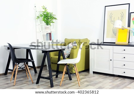 Modern room design. Furniture set with table and chairs - stock photo