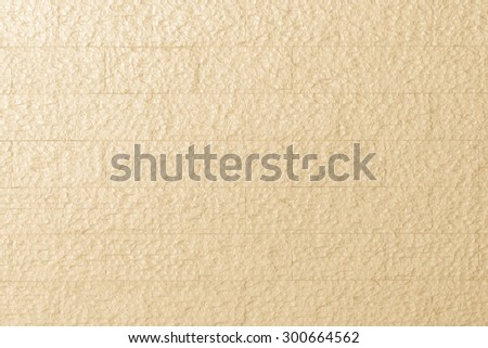 Modern rough marble rock tiled detail wall texture pattern background in pastel yellow cream color tone: Matte marble tile detailed backdrop in rustic vintage style for interior decoration and design  - stock photo
