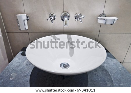 modern round hand wash basin with wall mount holders - stock photo