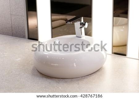 Modern round sink in the bathroom - stock photo