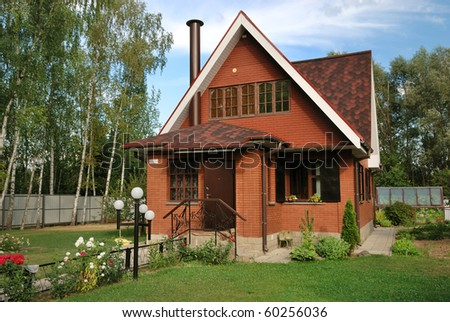 modern russian suburban house with lawn - stock photo
