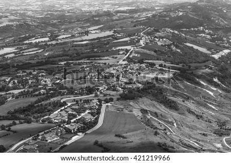 Modern San Marino Suburban districts and Italian hills view from above . Black and white photography. - stock photo