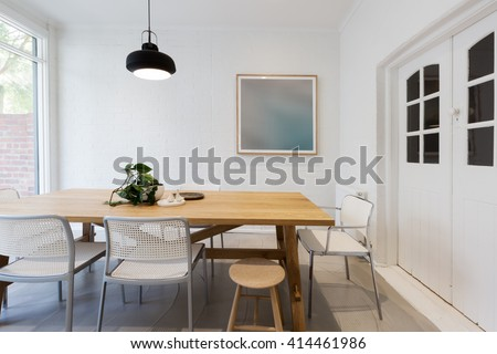 Modern Scandinavian Styled Interior Dining Room With Pendant Light In Australia Horizontal