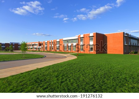 modern school building with lawn - stock photo