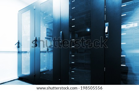 Modern server room interior with black computer cabinets - stock photo