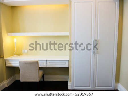 modern shelf and table in bedroom. - stock photo