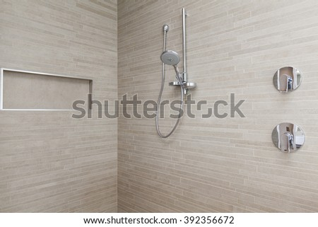 Modern shower and taps in bathroom