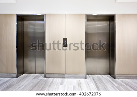 Modern silver elevator in a luxury building  with door closed - stock photo