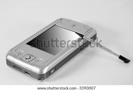 Modern silver Pocket PC with pen (focus on pen)