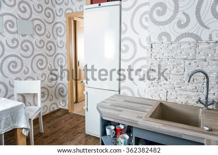 Modern simple kitchen interior design in light apartments - stock photo