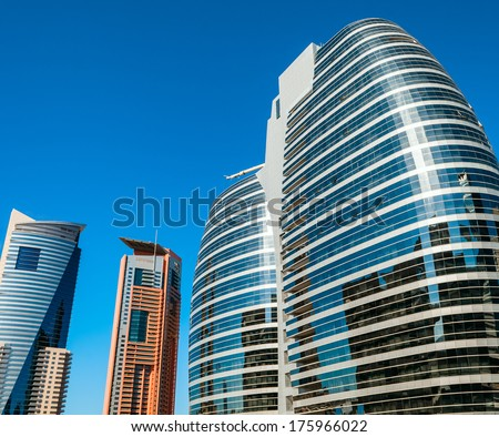 Modern skyscrapers against blue sky - stock photo