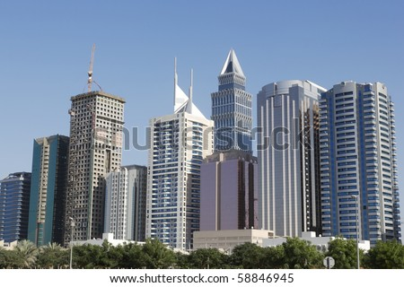 Modern skyscrapers in Dubai, United Arab Emirates. All trademarks are erased. - stock photo