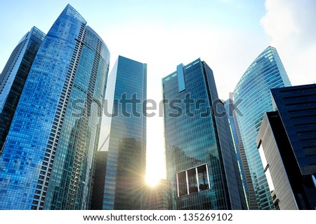 Modern skyscrapers in Singapore at sunset - stock photo