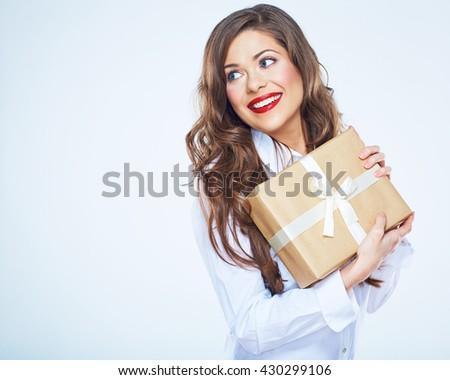 Modern smiling business woman holding gift box. Female portrait. - stock photo