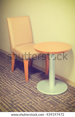 modern sofa chair and table in hotel room for a single person,  - stock photo