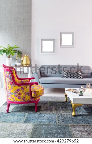 modern sofa living room with stone wall and classic armchair