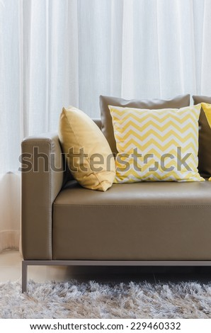 modern sofa with pillows in living room at home