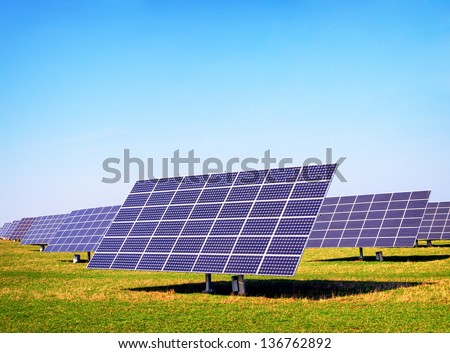 modern Solar Panels in front of blue sky - stock photo