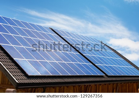 Modern solar panels on house roof in Europe. - stock photo