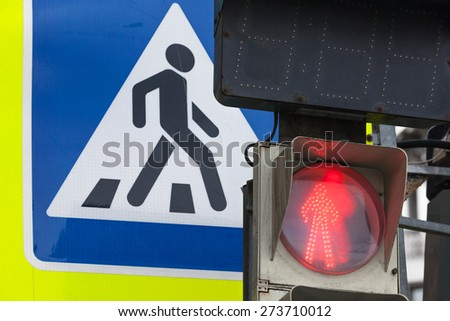 Modern square pedestrian crossing road sign and red traffic lights - stock photo