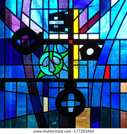 Modern stained glass window with cross and crossed keys, traditional Christian symbol of keys to the kingdom of God and of church authority - stock photo