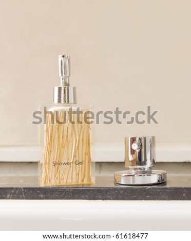Modern stainless steel tap with shower gel - stock photo