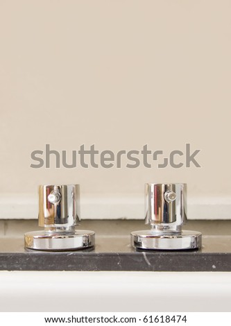 Modern stainless steel taps - stock photo